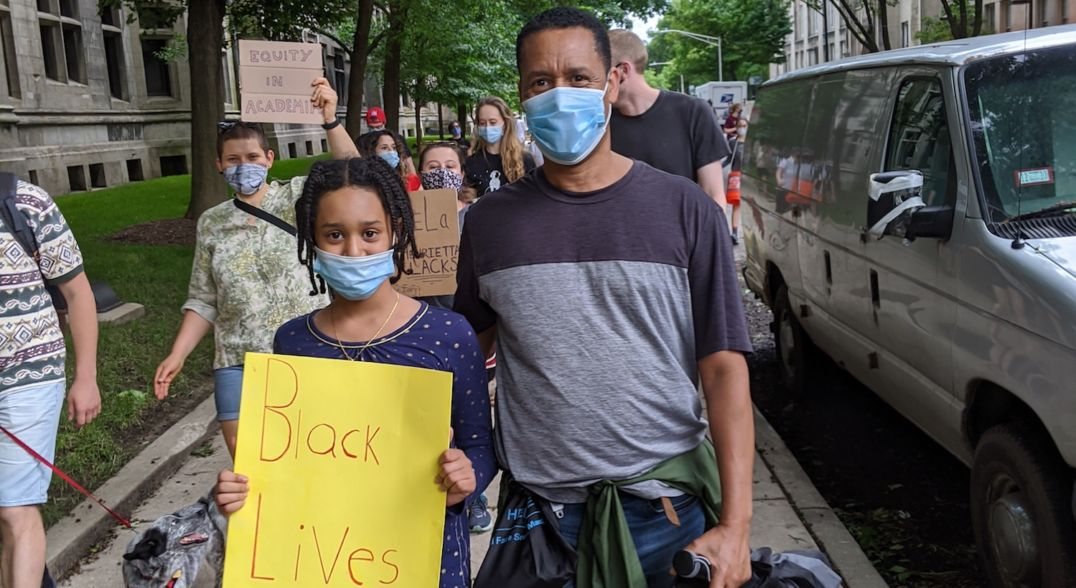 Author Zeray Alemseged and his daughter attend a Black Lives Matter protest in Chicago.